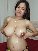 Busty Asian girl oils up her tits then sucks and fucks